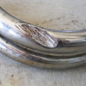 Dent on header pipe #4