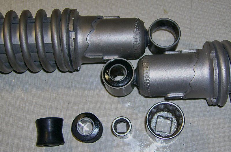 HD shocks (top one with bushing removed), bushings and sockets